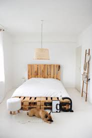 simple minimal yet elegant pallet bed frame in an all white decor choice