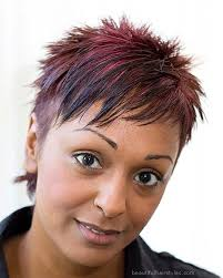 spick hair sytle for black women african american in short spiky hairstyle with red hair color