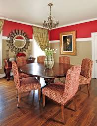 dining room with wall mirror and two toned wall color creative