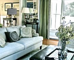living room with dark green sofa carameloffers fiona andersen