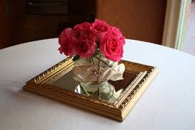 entrancing mirror center pieces with pink roses on the glass bowls