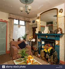 gilt mirror above fireplace in an old fashioned nineties