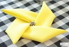 how to fold table napkins pinwheel napkin fold tutorial to set a festive table