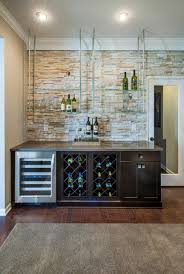 ceiling hanger shelves hang from joists garage basement create dynamic home bar with floating glass shelves that contrast the light stone accent wall