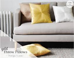 gold throw pillows from west elm a side of vogue