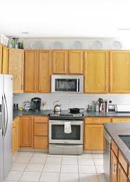 how to decorate the top of kitchen cupboards 12 ways to decorate above kitchen cabinets tag tibby design
