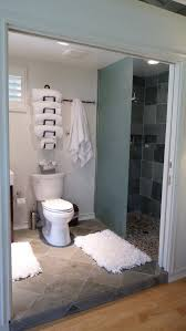 bathroom bathroom with over toilet towel storage hanging on white