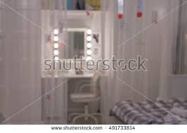 white contemporary dressing table blurred white modern dressing table dresser stock photo 491733814