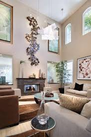 living room designed with high ceiling and fireplace under metal