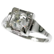 art deco engagement ring with high domed cushion cut old mine or