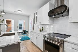 white shaker kitchen cabinets with gray quartz countertops white shaker semi custom kitchen cabinets with milford
