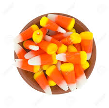top view of halloween candy corn kernels in a small bowl on a