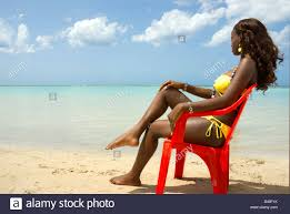 Chairs On A Beach Beautiful Black Sits In Red Chair On Beach Stock Photo