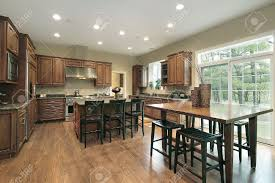eating kitchen island luxury kitchen with wood cabinets and eating area stock photo