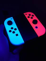 the neon joy cons glow under black light nintendoswitch imagethe