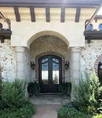 Cantera Stone Fireplaces by Cantera Stone For A Exterior With A Stone Column And Columns By