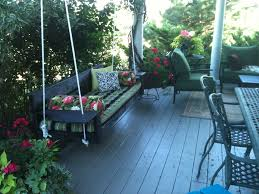 exterior black porch swings with decorative cushions and wrought