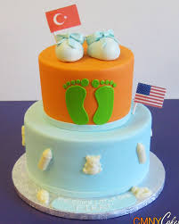 orange with green baby feet baby shower cake cmny cakes