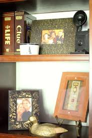 golden boys and me bookshelves updated with scrapbook paper