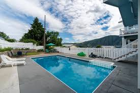 blue water pool house 4 bd vacation rental in manson wa vacasa