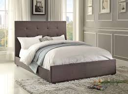 bedroom shag area rug and upholstered bed frame with bedding also