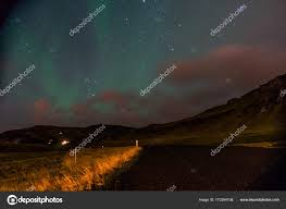 northern lights iceland november northern lights aurora borealis above landscape in iceland stock