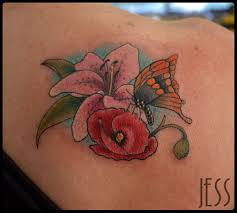 watercolor flower and sister tattoo on right arm by jess dunfield