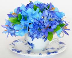 white and blue floral arrangements teacup silk floral arrangement blue bachelor buttons