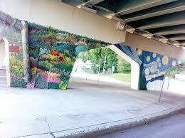 party to spotlight artists painting bypass bridge pillars local