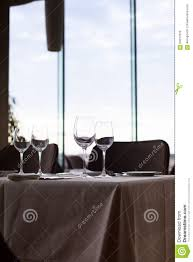 Modern Wine Glasses by Wine Glass And Flower Vase On Restaurant Table Stock Photo Image