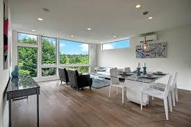 white washed hardwood floors dining room modern with cartwheel