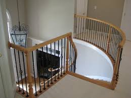 gorgeous home interior with curved staircase and iron balusters