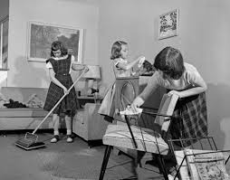 1950s three pre teen young girls cleaning living room dusting