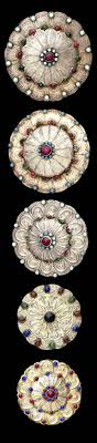 central asia five turkman silver gilt ornaments each of lobed