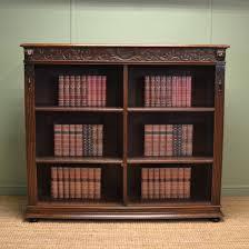 large victorian oak antique open bookcase with lion head carvings