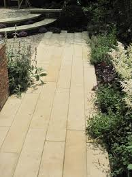 our buff sandstone plank paving looks gorgeous amongst the