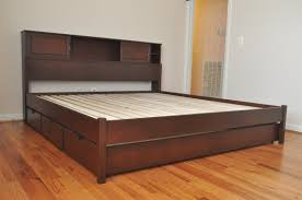 white flat king size platform bed frame with drawers and headboard