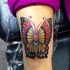 colorful butterfly on left half sleeve