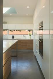 horizontal windows and a skylight contribute to making the kitchen