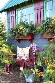 potting shed filling window boxes with greenery home