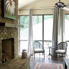 screened in porch with fireplace porch transitional with none