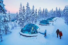 watch the northern lights from a glass igloo in finland