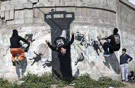 gaza man duped into banksy sale wants mural back toronto star palestinian youths practice their parkour skills on a mural said to have been painted by british