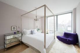 distressed canopy bed with chandelier contemporary bedroom