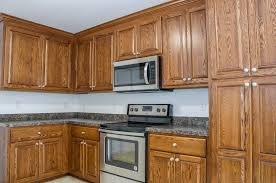 oak kitchen cabinets with stainless steel appliances new construction kitchen with wood cabinets and stainless