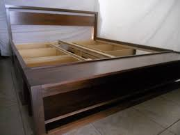 bedroom dark brown stained wooden platfor bed with headboard and