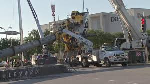 crane topples during construction at busy galleria area