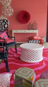 red living room with red ju ju hat on wall mr smiths interiors