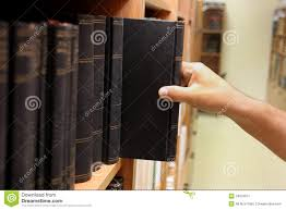 on a shelf reaching for book on a shelf royalty free stock photos