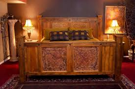 brown stained mahogany wood bed having carved footboard and